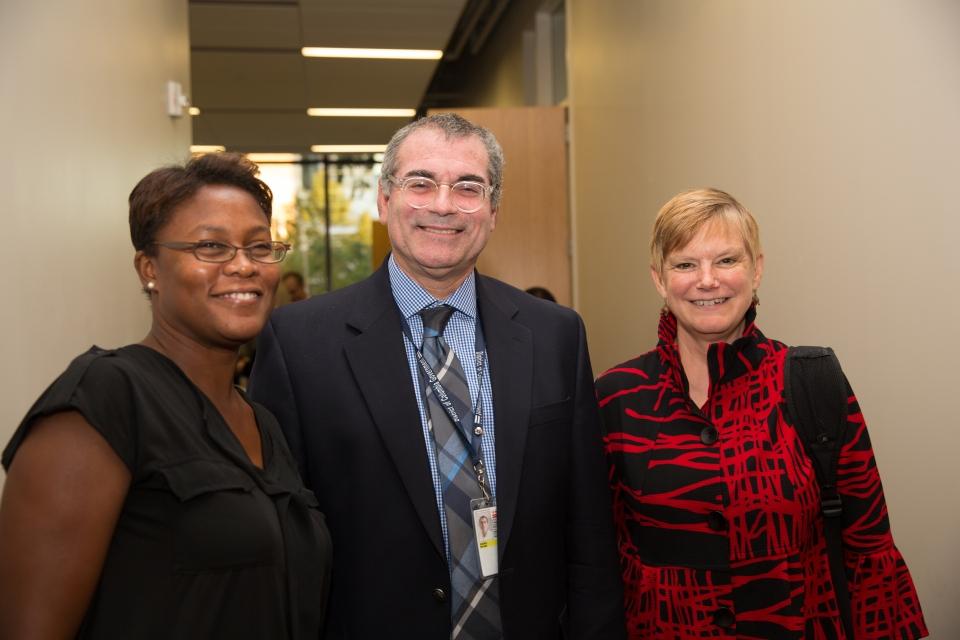 Three DC CFAR Investigators smile at the camera