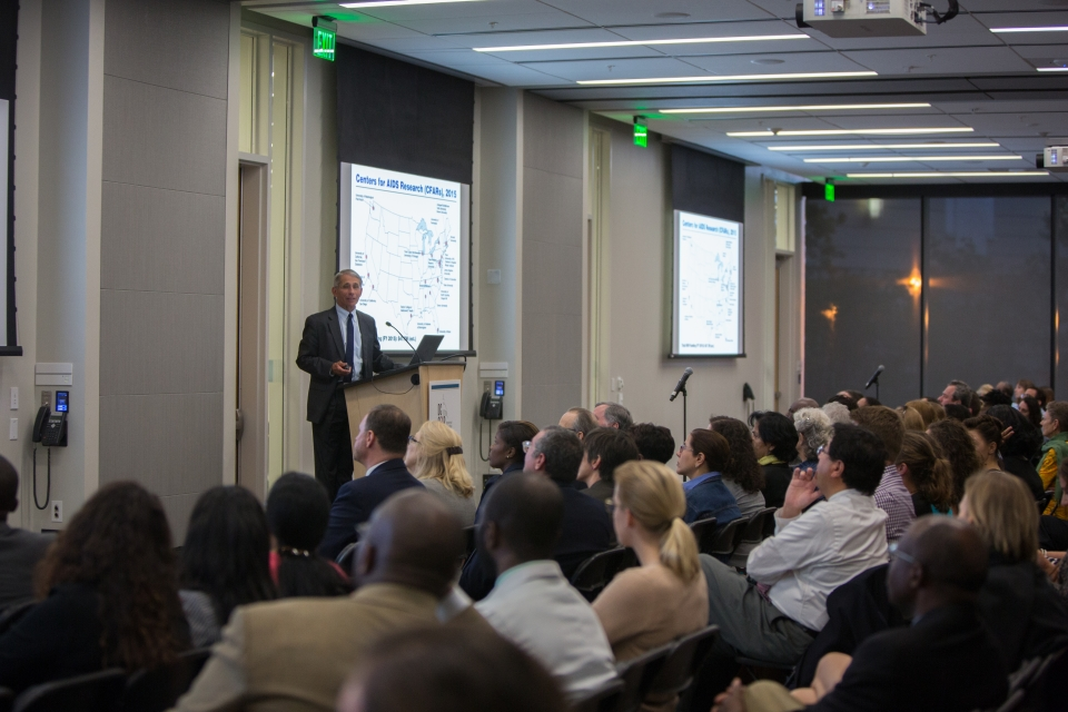 The audience listens to Dr. Fauci's presentation