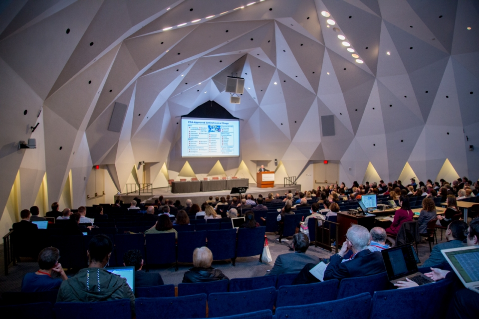 The audience listens to presentations in the National Academy of Science Auditorium