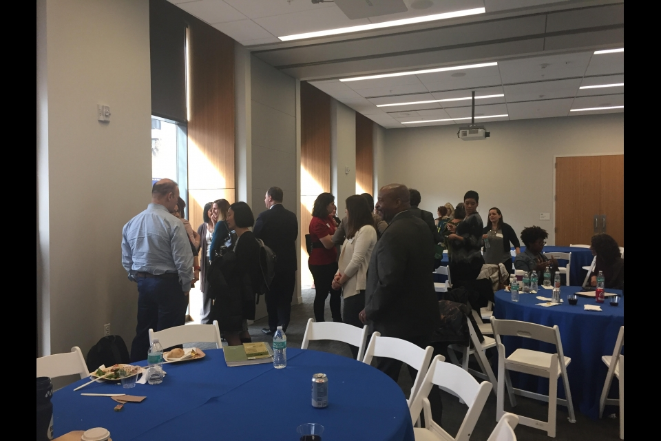 Guests interact around the conference room at the Annual Research Day 2018